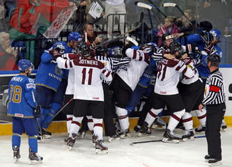 Players of Latvia and Kazakhstan scuffle on ice during the second period of their men's ice hockey World Championship Group B game at Minsk Arena in Minsk