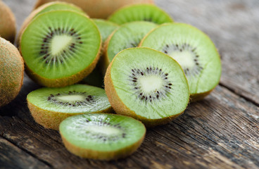 sliced kiwi fruit on wooden background