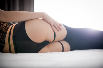 Beautiful ass butts woman in black knee socks and panties on bed at home