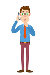 Businessman talking on mobile phone and standing with his finger to his lips