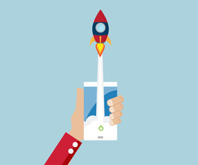 rocket launch from mobile start up business concept