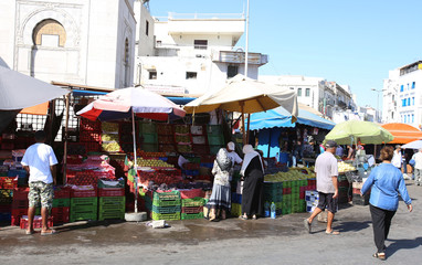 Women buy vegetables on a street market at  square  Sidi El Bechir in the old city in Tunis,