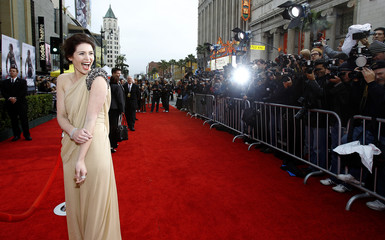 "Arterton laughs as she arrives at the premiere of ""Prince of Persia: The Sands of Time"" at the Grauman's Chinese Theatre in Hollywood"