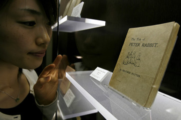 Assistant Takeda looks at the first edition of The Tale of Peter Rabbit in Higashi Matsuyama