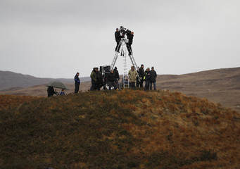 A film crew sets up to shoot a scene from the movie 'Under The Skin' in Glencoe, Scotland