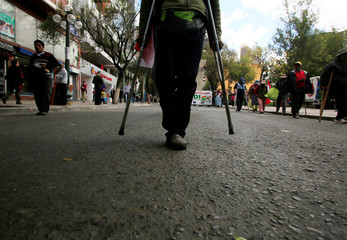 Demonstrators with physical disabilities participate in a rally protest calling on the government to provide a monthly subsidy rather than an annual one in La Paz