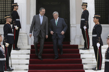 Greece's PM Samaras escorts his Luxembourg counterpart Juncker after their meeting in Athens