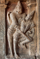 Hindu Lord Narasimha killing the evil. Indian rock-cut architecture of the 7th century temple, in town Pattadakal, India