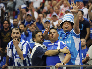 Greek fans get angry during their Group A Euro 2012 soccer match against Poland in Warsaw