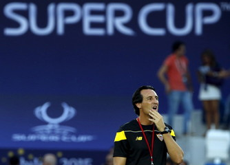 Sevilla's coach Emery attends a training session on the eve of the UEFA Super Cup soccer match against Barcelona in Tbilisi