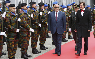 Belgian Prime Minister Di Rupo and his Moroccan counterpart Benkirane review troops during a welcoming ceremony in Brussels
