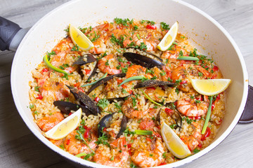 Paella with shrimps and mussels. Traditional Spanish dish