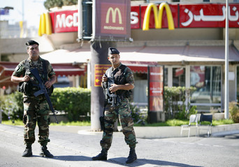 Lebanese soldiers stand in front of a McDonald's fast food outlet in Beirut