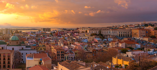 Wide angle panorama of Cagliari old city center during the sunset, dramatic sky above the biggest city of Sardinia, Italy Wall mural