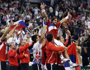 Tipsarevic of Serbia celebrates with teammates after beating Czech Republic in their Davis Cup world group semi-final tennis match in Belgrade