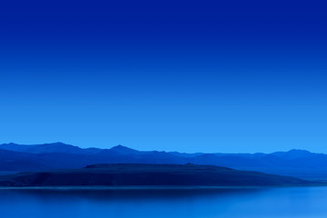 Blue Night Lake with Mountains Background