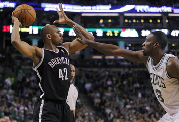 Brooklyn Nets' Stackhouse looks to pass against Boston Celtics' Green in the first half of their NBA basketball game at TD Garden in Boston