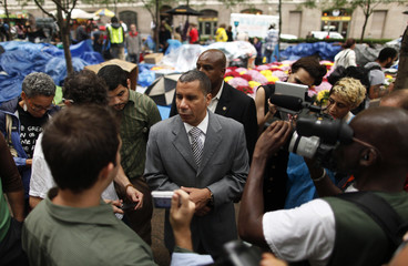 Former New York Governor Paterson stops to talk to demonstrators from the Occupy Wall Street campaign in Zucotti Park near the financial district of New York