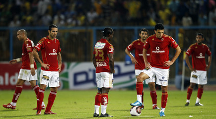 Al Ahly players react after conceding a third goal during their Egyptian Premier League derby soccer match against El Ismaily at Ismailia stadium