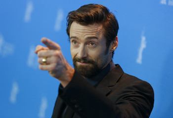 """Actor Jackman gestures during a photocall to promote the film """"Les Miserables"""" at the 63rd Berlinale International Film Festival in Berlin"""