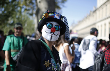 People participate in the 18th edition of the Techno Parade music event in Paris