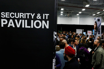 People attend the Security and IT pavilion during the TechCrunch Disrupt event in Manhattan, in New York City
