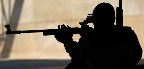 A competitor practices at the Barry Buddon shooting centre at the 2014 Commonwealth Games in Glasgow, Scotland