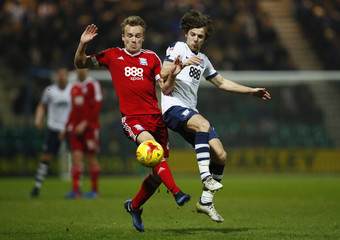 Preston North End's Ben Pearson and Birmingham City's Maikel Kieftenbeld in action