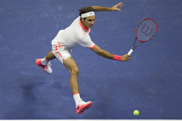 Federer of Switzerland returns a shot to Djokovic of Serbia during their men's singles final match at the U.S. Open Championships tennis tournament in New York