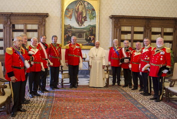 Pope Francis poses with the Grand Master of the Sovereign Order of Malta, Fra' Matthew Festing and delegates, during a private audience in the Pontiff's private library at the Vatican