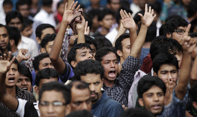 Students of Jagannath University shout slogans as they block a road near the High Court in Dhaka