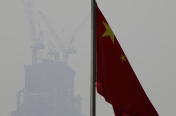 A Chinese flag is seen near a construction site in Beijing's central business area