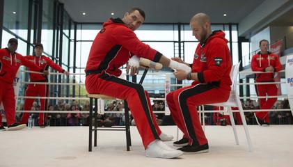 Ukrainian WBO, IBO and IBF heavy weight boxing world champion Klitschko has hands taped during public training session in Hamburg
