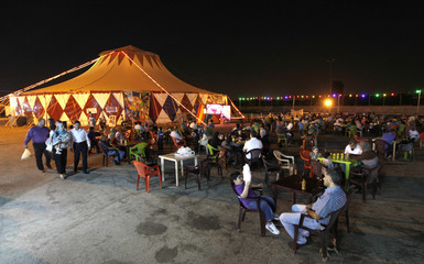 Residents wait outside the Umbrella Circus tent in Baghdad
