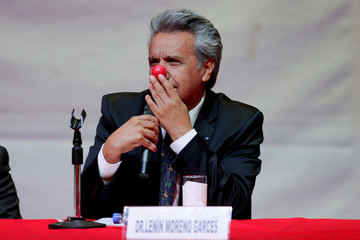 """Ecuadorian politician Lenin Voltaire Moreno plays with a clown nose as he addresses students after he was awarded the """"Doctor Honoris Causa"""" degree from The National University of El Salvador in San Salvador"""