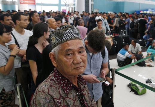 Lion Air passengers stand in line to claim their tickets money back after their flights were delayed at Soekarno-Hatta airport in Jakarta