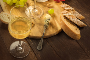 Wine and cheese tasting, with bread and grapes