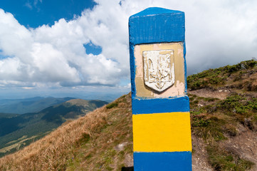 Ukraine border. Frontier in Carpatian mountains, as a symbol of visa-free regime with Europe. Open Ukraine and Europian Union travel concept