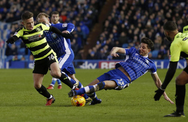 Jack Payne of Huddersfield Town in action with Sam Hitchinson of Sheffield Wednesday before being shown the red card by referee Graham Scott for an off the ball incident following the challenge