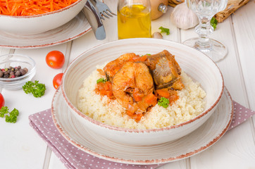 Fish stewed in tomato sauce with vegetables