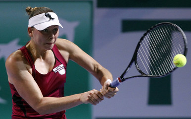 Zvonareva of Russia hits a return to Radwanska of Poland during their WTA tennis championships match in Istanbul