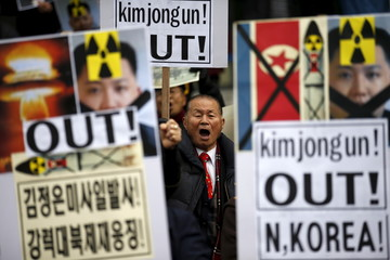 A man chants slogans during an anti-North Korea rally in central Seoul