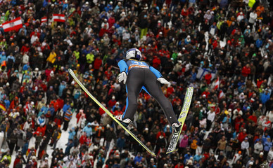 Austria's Thomas Morgenstern soars over the spectators during the first event of the 60th four-hills ski jumping tournament in Oberstdorf