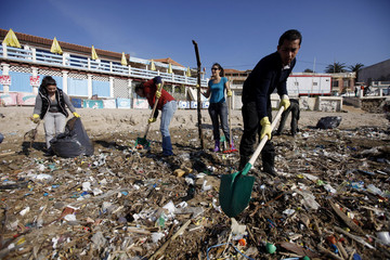 Volunteers collect rubbish along Tamenfoust beach in the east of Algiers
