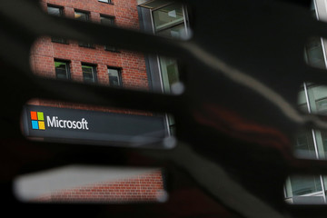 A bench frames a sign outside the Microsoft office in Cambridge