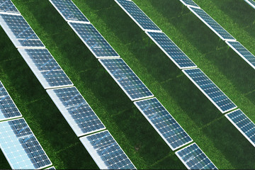 3D illustration Solar energy concept. Solar panels on grass. Blue sky reflection on photovoltaic panel. Power, ecology, technology, electricity.