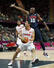 Bryant of the U.S. tries to block the shot of Tunisia's El Mabrouk during their men's preliminary round Group A basketball match at the Basketball Arena during the London 2012 Olympic Games