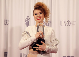 Singer Kiesza poses backstage with the three Juno awards that she won at the 2015 Juno Awards in Hamilton