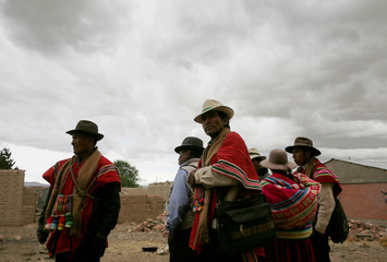 Aymara indigenous people gather for a ritual to demand rain during the worst drought in 25 years in Caracollo