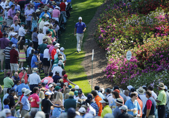 Australia's Adam Scott walks down the sixth hole during the third round of the Masters golf tournament at the Augusta National Golf Club in Augusta